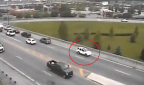 Video shows car driving in reverse on highway
