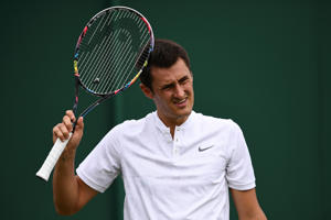 Australia's Bernard Tomic reacts against Germany's Mischa Zverev during their men's singles first round match on the second day of the 2017 Wimbledon Championships at The All England Lawn Tennis Club in Wimbledon, southwest London, on July 4, 2017. Zverev won the match 6-4, 6-3, 6-4. / AFP PHOTO / Justin TALLIS / RESTRICTED TO EDITORIAL USE        (Photo credit should read JUSTIN TALLIS/AFP/Getty Images)