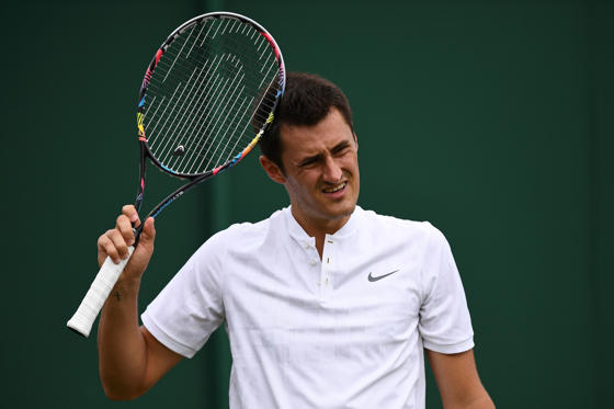 Slide 1 of 12: Australia's Bernard Tomic reacts against Germany's Mischa Zverev during their men's singles first round match on the second day of the 2017 Wimbledon Championships at The All England Lawn Tennis Club in Wimbledon, southwest London, on July 4, 2017. Zverev won the match 6-4, 6-3, 6-4. / AFP PHOTO / Justin TALLIS / RESTRICTED TO EDITORIAL USE        (Photo credit should read JUSTIN TALLIS/AFP/Getty Images)