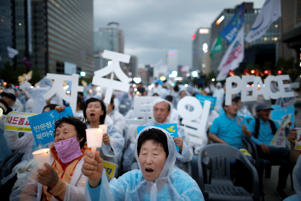 People attend a candlelight vigil wishing for a successful summit between the U.S. and North Korea, in front of U.S. embassy in central Seoul, South Korea, June 9, 2018.