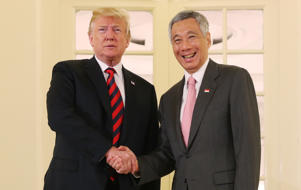 U.S. President Donald Trump and Singapore's Prime Minister Lee Hsien Loong shake hands during a meeting at the Istana in Singapore June 11, 2018.  REUTERS/Jonathan Ernst