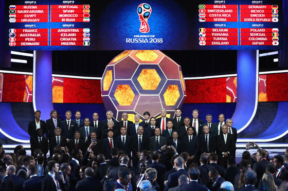 Slide 1 of 49: MOSCOW, RUSSIA - DECEMBER 01:  The national team managers pose for a photo on the stage during the Final Draw for the 2018 FIFA World Cup Russia at the State Kremlin Palace on December 1, 2017 in Moscow, Russia.  (Photo by Lars Baron - FIFA/FIFA via Getty Images)