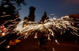 A reveler holds fireworks as he takes part in 'Correfoc' (Run with fire) party during the night of San Juan in Barcelona, Spain, Friday, June 23, 2017. The San Juan night coincides with the Summer solstice and it's the welcome to Summer. This celebration takes place during the shortest night of the year in almost all cities and towns of Spain.