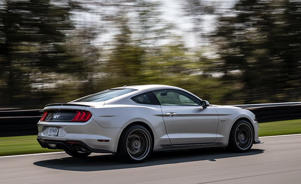 a car parked on the side of a road: Ford Mustang GT Performance Pack Level 2 Puts the Focus on the Track