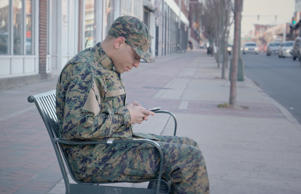 Military Man Texting with Smartphone