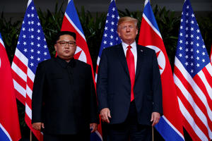 President Donald Trump meets with North Korean leader Kim Jong Un on Sentosa Island in Singapore.