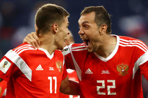Artem Dzyuba and Roman Zobnin of Russia celebrate the first Russia goal, an own goal by Ahmed Fathi of Egypt, during the 2018 FIFA World Cup Russia group A match between Russia and Egypt at Saint Petersburg Stadium on June 19, 2018 in Saint Petersburg, Russia.