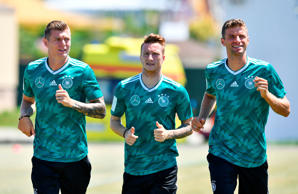 L to R, Germany's midfielder Toni Kroos, Germany's forward Marco Reus and Germany's forward Thomas Mueller take part in a training session at the Olympic Park Arena in Sochi on June 21
