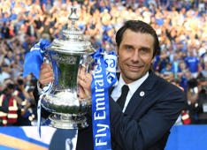 LONDON, ENGLAND - MAY 19:  Antonio Conte, Manager of Chelsea poses with the Emirates FA Cup trophy following his sides win in The Emirates FA Cup Final between Chelsea and Manchester United at Wembley Stadium on May 19, 2018 in London, England.  (Photo by Darren Walsh/Chelsea FC via Getty Images)