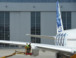 Employees of Airbus inspect an A350 plane