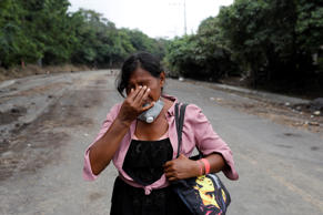 "Eufemia Garcia, 48, who lost 50 members of her family during the eruption of the Fuego volcano, reacts after a day searching for her family in San Miguel Los Lotes in Escuintla, Guatemala, June 15, 2018. REUTERS/Carlos Jasso  SEARCH ""EUFEMIA MISSING"" FOR THIS STORY. SEARCH ""WIDER IMAGE"" FOR ALL STORIES."