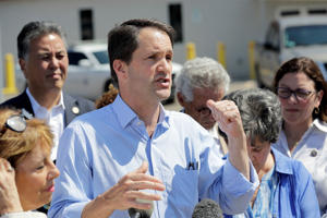 "Caption: Rep. Jim Himes, D-Conn., talks about the immigrant children being being held in the U.S. Border Patrol Central Processing Center after touring the facility Saturday, June 23, 2018, in McAllen, Texas. Over 2,000 children were taken from their families in recent weeks under a Trump administration ""zero tolerance"" policy in which people entering the U.S. illegally face being prosecuted. Parents and children were being detained separately. But after public outcry, President Donald Trump on Wednesday ordered that they be brought back together."