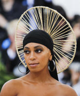 "Singer-Songwriter Solange Knowles arrives at the Metropolitan Museum of Art Costume Institute Gala (Met Gala) to celebrate the opening of ""Heavenly Bodies: Fashion and the Catholic Imagination"" in the Manhattan borough of New York, U.S., May 7, 2018. REUTERS/Carlo Allegri"
