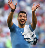 Uruguay's Luis Suarez celebrates after the match