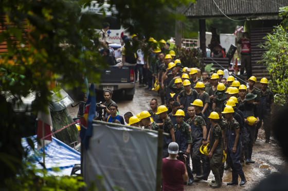 "Slide 1 of 75: Rescue personnel arrive as rescue operations continue for 12 boys and their coach trapped at Tham Luang cave at Khun Nam Nang Non Forest Park in the Mae Sai district of Chiang Rai province on July 5, 2018. - Thai rescuers vowed to take a ""no risk"" approach to freeing 12 boys and their football coach from a flooded cave, as fresh video emerged on July 4 showing the team in good spirits following their astonishing discovery nine days after going missing. (Photo by YE AUNG THU / AFP)        (Photo credit should read YE AUNG THU/AFP/Getty Images)"