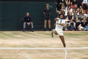 Arthur Ashe in action on Centre Court.
