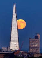 Strawberry Moon, London, UK - 28 Jun 2018 A full moon known as a strawberry moon rises behind the Shard skyscraper after another hot summer day in London