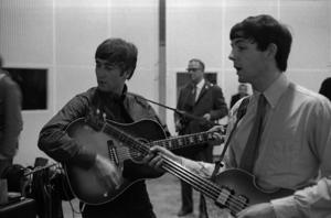 John Lennon and Paul McCartney of The Beatles in Studio 2 at Abbey Road in London recording the single 'She Loves You', 1st July 1963.