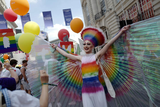 Slide 1 of 101: TOPSHOT - Members of the Lesbian, Gay, Bisexual and Transgender (LGBT) community take part in the annual Pride Parade in London on July 7, 2018. (Photo by Tolga AKMEN / AFP)        (Photo credit should read TOLGA AKMEN/AFP/Getty Images)