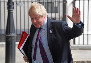 Britain's Foreign Secretary Boris Johnson waves as he leaves Downing Street in London, Britain, June 28, 2018