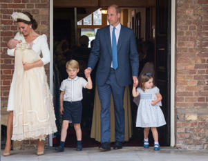 Britain's Prince William and Catherine, the Duchess of Cambridge, leave the chapel with their children Prince George, Princess Charlotte and Prince Louis after Prince Louis's christening in the Chapel Royal, St James's Palace, London, Britain, July 9, 2018. Dominic Lipinski/Pool via REUTERS