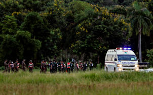 An ambulance carrying rescued schoolboys leaves a military airport in Chiang Rai, Thailand, July 10, 2018.
