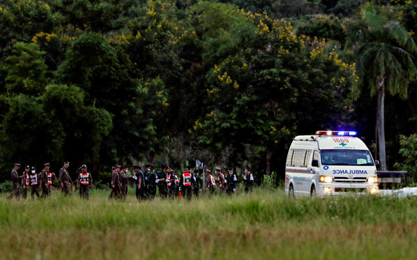 Slide 1 of 102: An ambulance carrying rescued schoolboys leaves a military airport in Chiang Rai, Thailand, July 10, 2018.