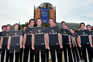 Global activists of  Avaaz, set up cardboard cutouts of Facebook chief Mark Zuckerberg, on which is written  'Fix Fakebook', in front of the European Union headquarters in Brussels, on May 22, 2018, as they call attention to what the groups says are hundreds of millions of fake accounts still spreading disinformation on Facebook. - Advocacy group Avaaz is calling attention to what the groups says are hundreds of millions of fake accounts still spreading disinformation on Facebook. Facebook chief will say sorry to the European Parliament on May 22, 2018, pledging that the social media giant has learned hard lessons from a massive breach of users' personal data. Facebook admitted that up to 87 million users may have had their data hijacked by British consultancy Cambridge Analytica, which worked for US President Donald Trump during his 2016 campaign. (Photo by JOHN THYS / AFP)        (Photo credit should read JOHN THYS/AFP/Getty Images)