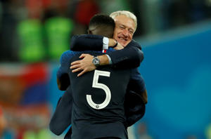 Soccer Football - World Cup - Semi Final - France v Belgium - Saint Petersburg Stadium, Saint Petersburg, Russia - July 10, 2018  France coach Didier Deschamps celebrates with Samuel Umtiti at the end of the match   REUTERS/Lee Smith     TPX IMAGES OF THE DAY