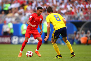 Jesse Lingard of England competes with Albin Ekdal of Sweden  during the 2018 FIFA World Cup Russia Quarter Final match between Sweden and England at Samara Arena on July 7, 2018 in Samara, Russia.