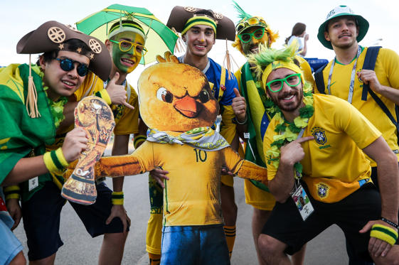Slide 1 of 103: KAZAN, RUSSIA - JULY 6, 2018: Supporters of Brazil with a cutout pose for a photograph outside Kazan Arena before a 2018 FIFA World Cup quarterfinal football match between Brazil and Belgium. Yegor Aleyev/TASS (Photo by Yegor Aleyev\TASS via Getty Images)
