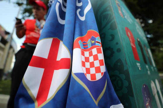 Slide 1 of 55: England and Croatia flags outside the stadium before the match  q