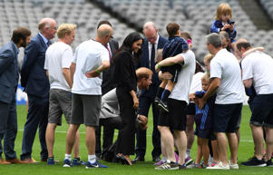 Harry and Meghan, the Duchess of Sussex, meet some of the participants after watching a demonstration of traditional Gaelic sports at Croke Park in Dublin, Ireland, July 11, 2018. REUTERS/Cathal McNaughton