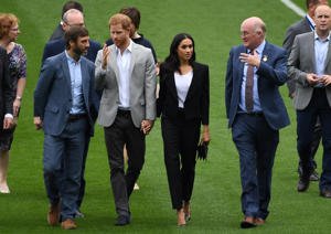 Prince Harry and Meghan, the Duchess of Sussex, watch a demonstration of traditional Gaelic sports at Croke Park in Dublin, Ireland, July 11, 2018. REUTERS/Cathal McNaughton