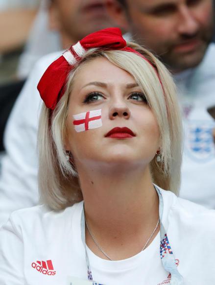 الشريحة 26 من 46: Soccer Football - World Cup - Semi Final - Croatia v England - Luzhniki Stadium, Moscow, Russia - July 11, 2018 England fan inside the stadium before the match REUTERS/Grigory Dukor