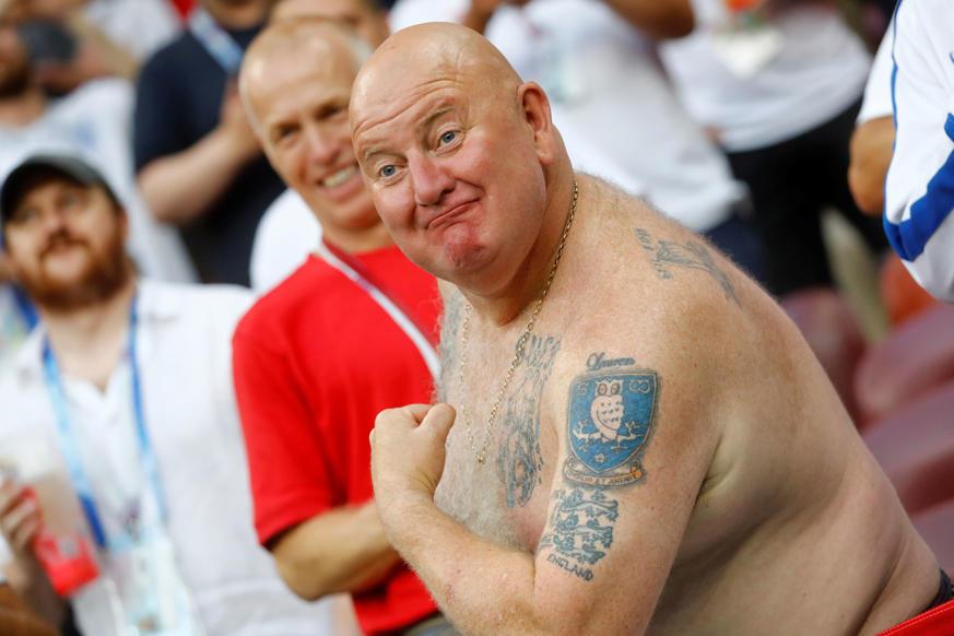 الشريحة 28 من 46: Soccer Football - World Cup - Semi Final - Croatia v England - Luzhniki Stadium, Moscow, Russia - July 11, 2018 England fan inside the stadium before the match REUTERS/Kai Pfaffenbach
