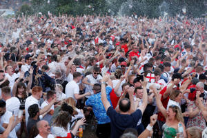 Soccer Football - World Cup - England fans watch Croatia v England - Nottingham Castle, Nottingham, Britain - July 11, 2018   England fans celebrate after their first goal during the match    Action Images via Reuters/Peter Cziborra