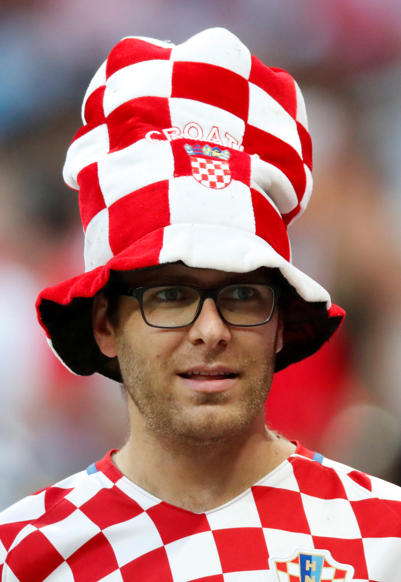 الشريحة 10 من 46: Soccer Football - World Cup - Semi Final - Croatia v England - Luzhniki Stadium, Moscow, Russia - July 11, 2018 Croatia fan inside the stadium before the match REUTERS/Maxim Shemetov