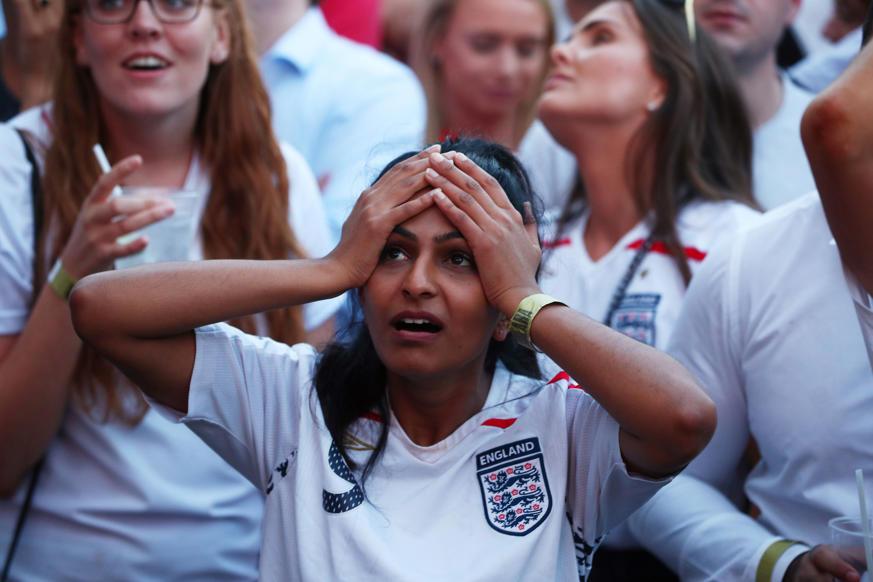 الشريحة 53 من 58: Soccer Football - World Cup - England fans watch Croatia v England - Flat Iron Square, London, Britain - July 11, 2018 England fans look dejected after Croatia's first goal REUTERS/Hannah Mckay