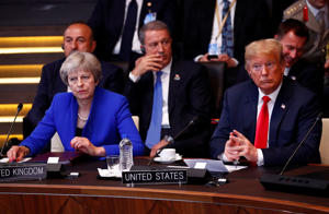 Britain's Prime Minister Theresa May and U.S. President Donald Trump attend a meeting of the North Atlantic Council during a NATO summit in Brussels, Belgium July 11, 2018. REUTERS/Francois Lenoir