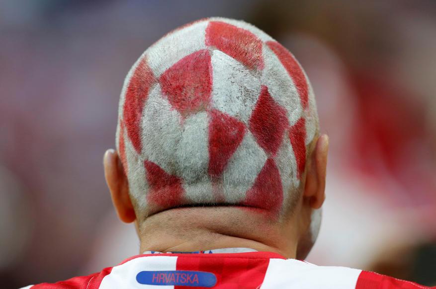 الشريحة 2 من 46: Soccer Football - World Cup - Semi Final - Croatia v England - Luzhniki Stadium, Moscow, Russia - July 11, 2018 Croatia fan before the match REUTERS/Darren Staples