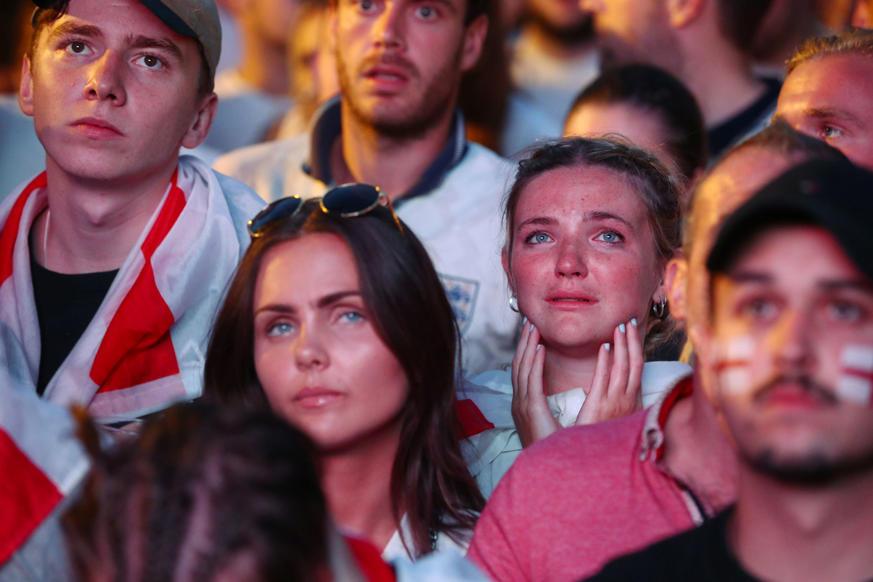 الشريحة 58 من 58: Soccer Football - World Cup - England fans watch Croatia v England - Flat Iron Square, London, Britain - July 11, 2018 England fans react after the match REUTERS/Hannah Mckay