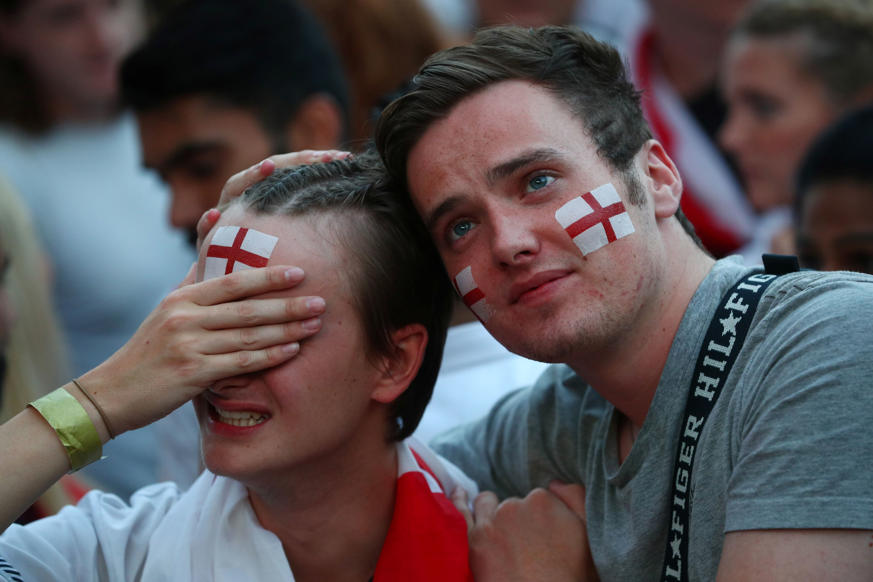الشريحة 4 من 58: Soccer Football - World Cup - England fans watch Croatia v England - Flat Iron Square, London, Britain - July 11, 2018 England fans react REUTERS/Hannah Mckay