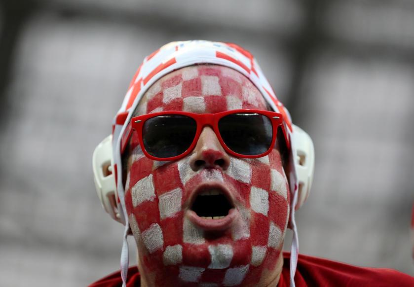 الشريحة 13 من 46: Soccer Football - World Cup - Semi Final - Croatia v England - Luzhniki Stadium, Moscow, Russia - July 11, 2018 Croatia fan wearing facepaint inside the stadium before the match REUTERS/Carl Recine