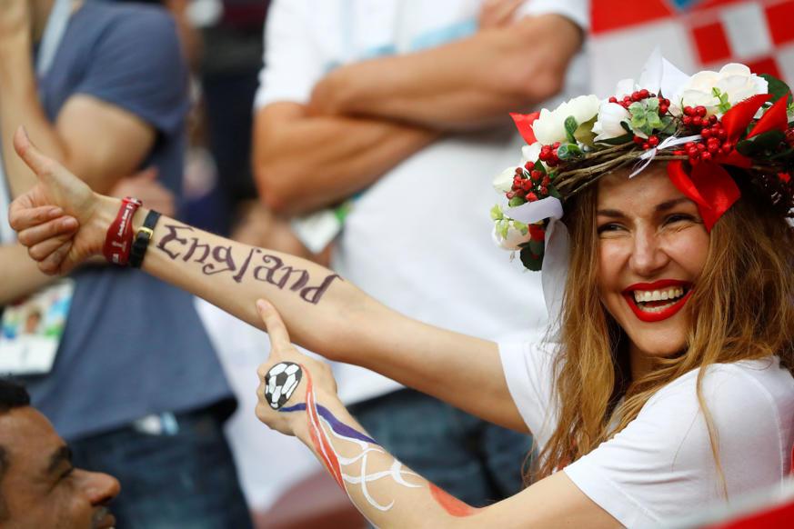 الشريحة 24 من 46: Soccer Football - World Cup - Semi Final - Croatia v England - Luzhniki Stadium, Moscow, Russia - July 11, 2018 England fan inside the stadium before the match REUTERS/Kai Pfaffenbach