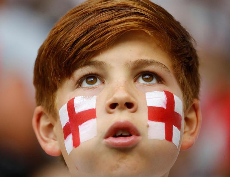 الشريحة 43 من 46: Soccer Football - World Cup - Semi Final - Croatia v England - Luzhniki Stadium, Moscow, Russia - July 11, 2018 England fan inside the stadium before the match REUTERS/Kai Pfaffenbach
