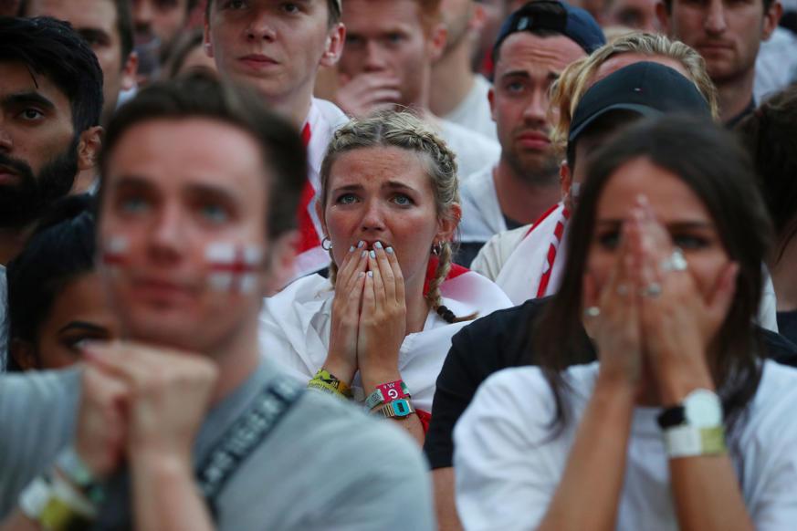 الشريحة 17 من 58: Soccer Football - World Cup - England fans watch Croatia v England - Flat Iron Square, London, Britain - July 11, 2018 England fan reacts REUTERS/Hannah Mckay