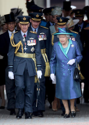 Queen Elizabeth II walks with Air Chief Marshal Sir Stephen Hillier at the RAF 100 ceremony, as members of the Royal Family attend events to mark the centenary of the RAF on July 10, 2018 in London, England.