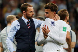 England manager Gareth Southgate consoles Dele Alli after the match
