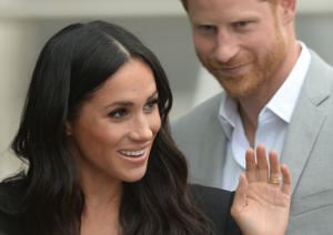Britain's Prince Harry and Meghan, the Duchess of Sussex, waves at well-wishers during a walkabout in Dublin, Ireland, July 11, 2018. REUTERS/Clodagh Kilcoyne